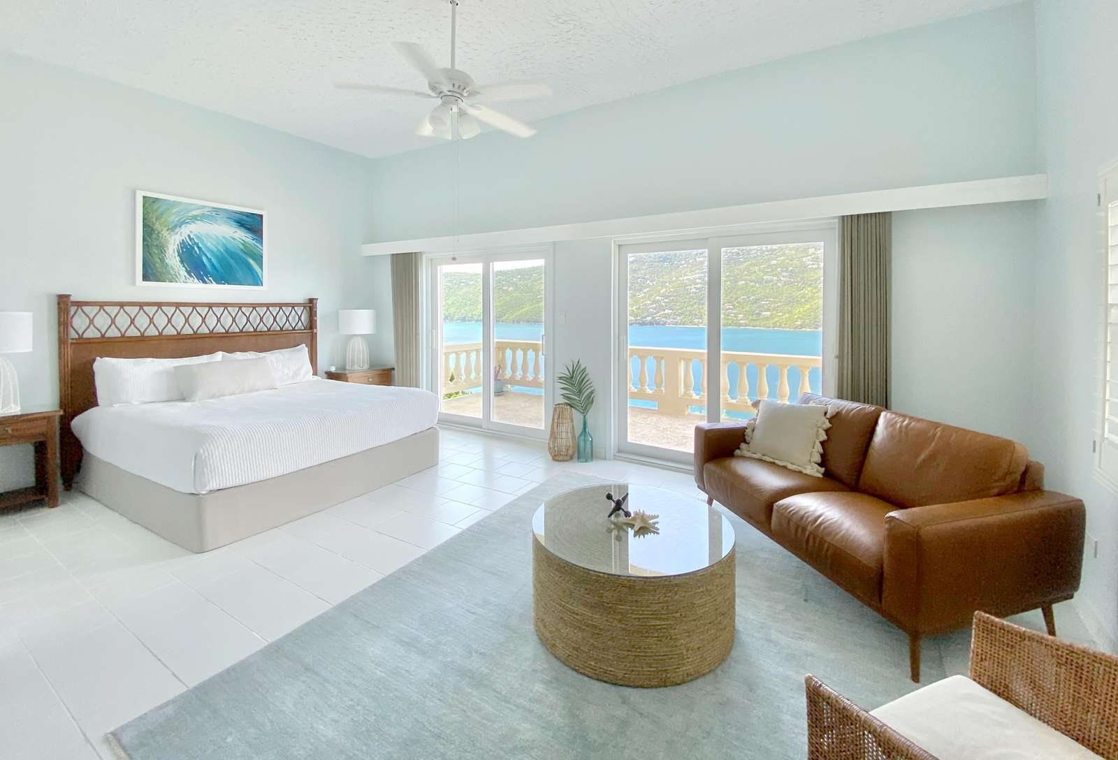 King bed and seating area with private terrace and views of Magens Bay & the pool in the main living area of the Pool Level Casita Apartment