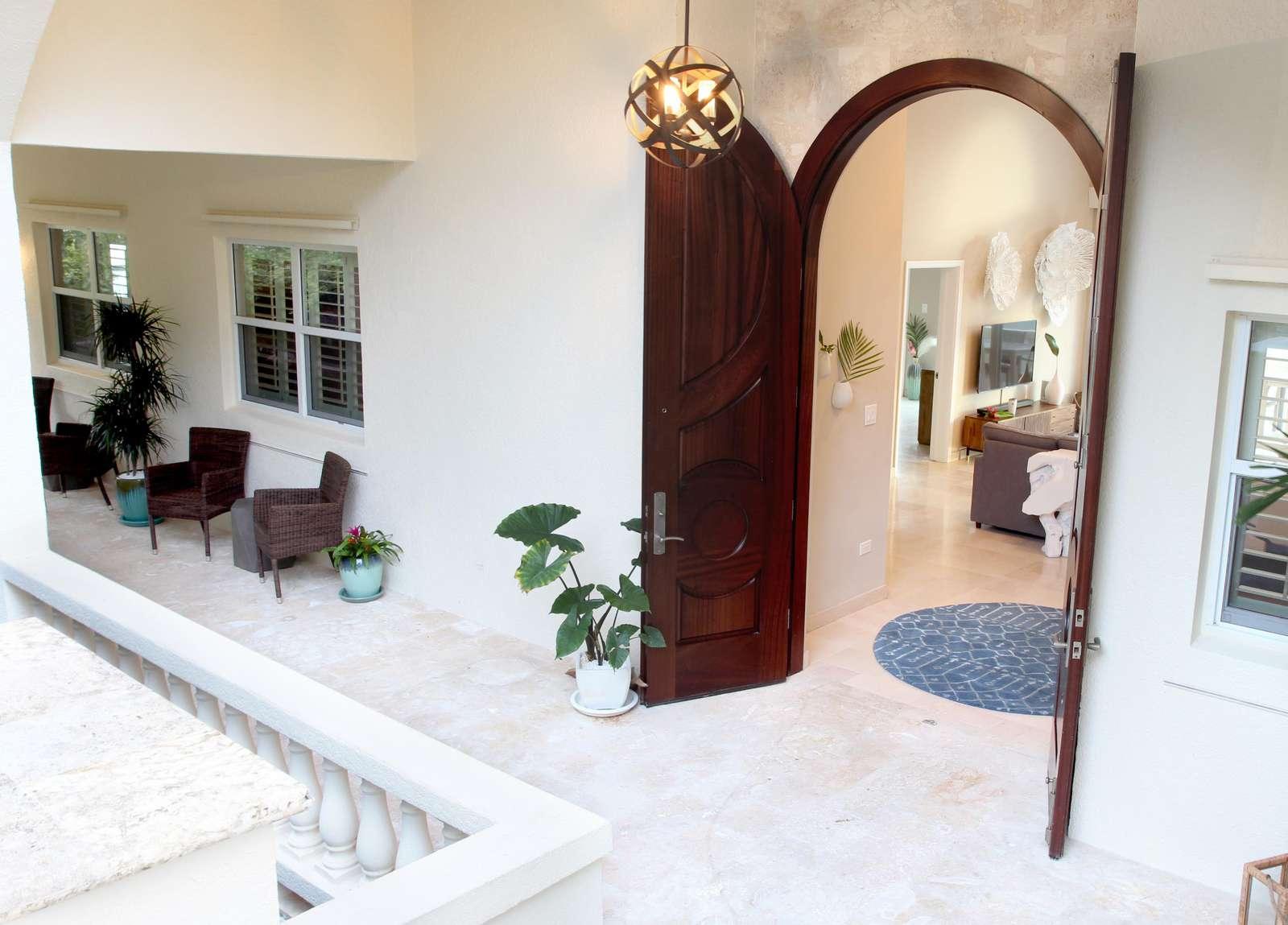 Step through Pallina's stately mahogany doors into the foyer