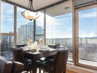 Gorgeous views for dining.  Table pulls out to sit six. thumb