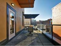 You can window shop from your private patio with seating for six. thumb