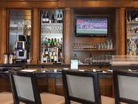 Pop down for a nightcap or enjoy dinner at the Oswego Bistro thumb