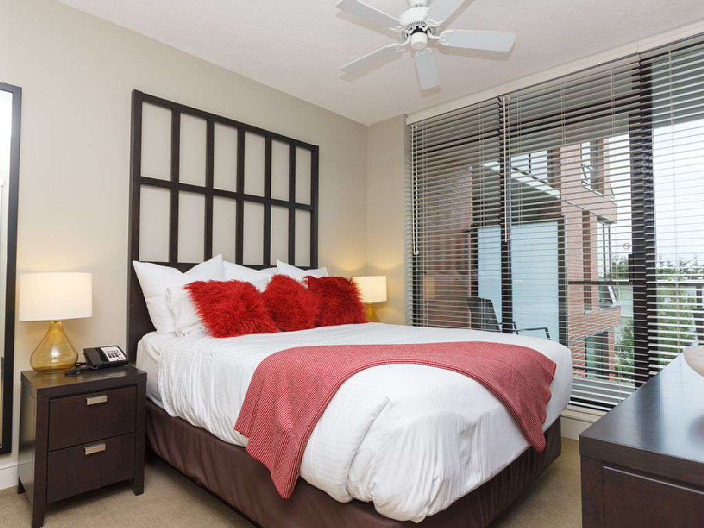 Beautiful queen bedroom with walk out patio - property