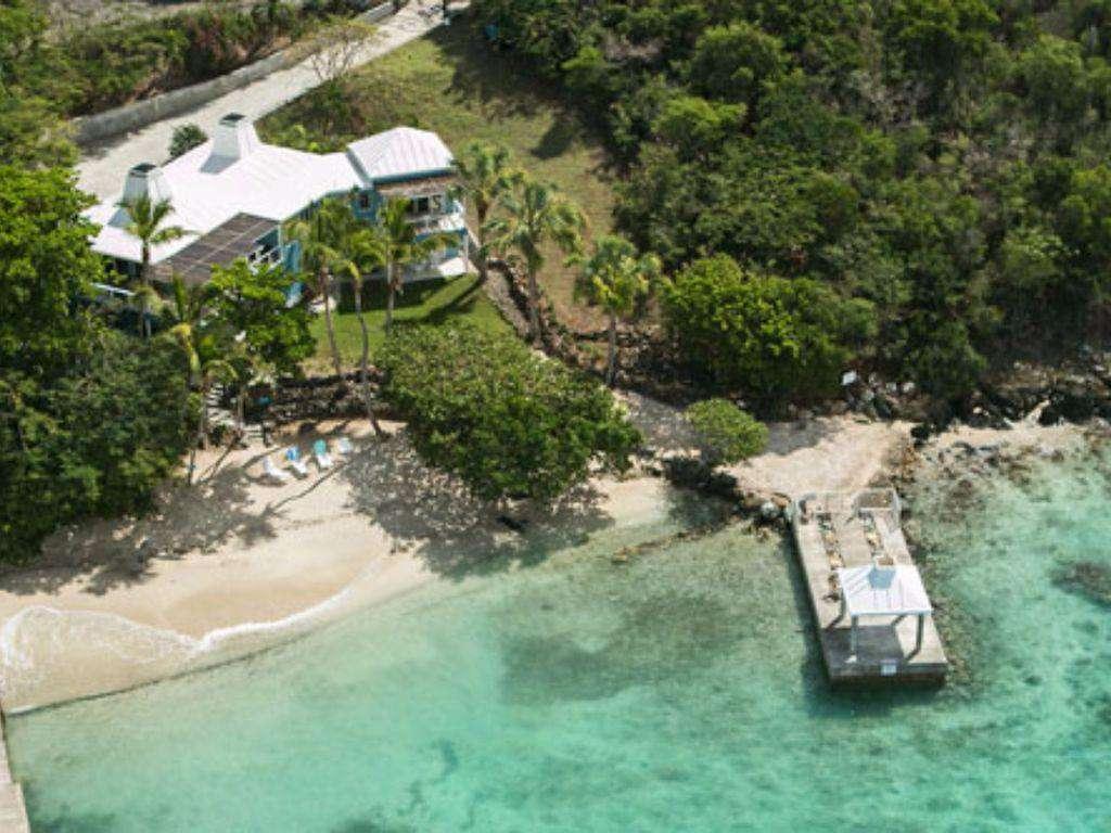 True Beachfront Villa with Private Dock - property
