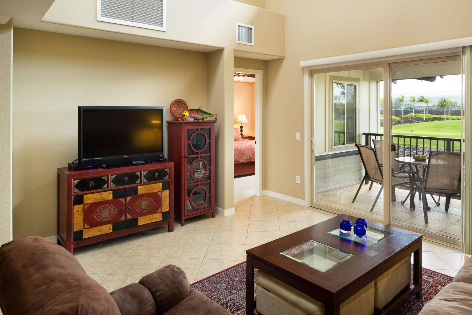 Open floor plan, large living room, with high ceilings opens up onto the lanai