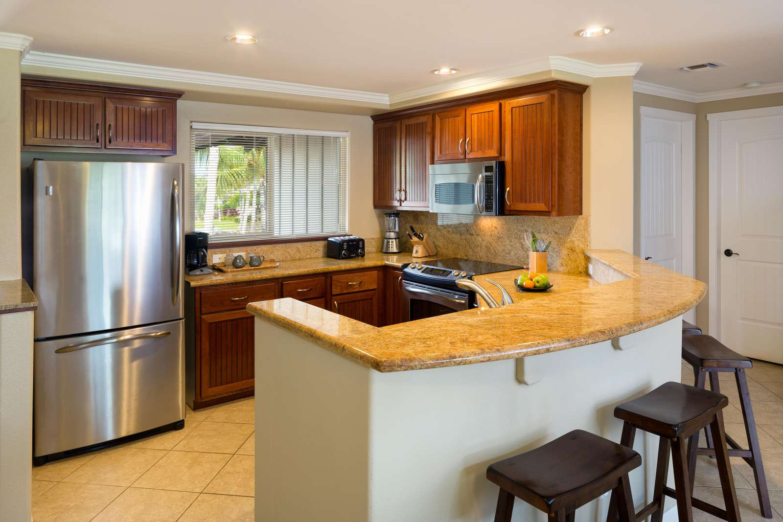 Large kitchen, stainless steel appliances, granite counter tops and hard wood cabinets