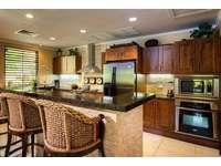 Gourmet kitchen with breakfast bar thumb