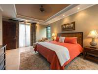 Another view of the master suite with king bed thumb