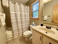 Main Level Bathroom Offers a Jetted Tub/Shower Combo thumb