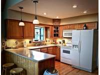 Solid surface Counter tops and a well appointed Kitchen thumb
