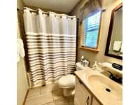 There is a full bathroom on each level of the cabin thumb