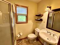 Upstairs Full Bathroom Offers a Stand-Up Shower thumb