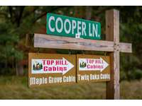 Cooper Lane Sign for Twin Oaks and Maple Grove Cabins thumb