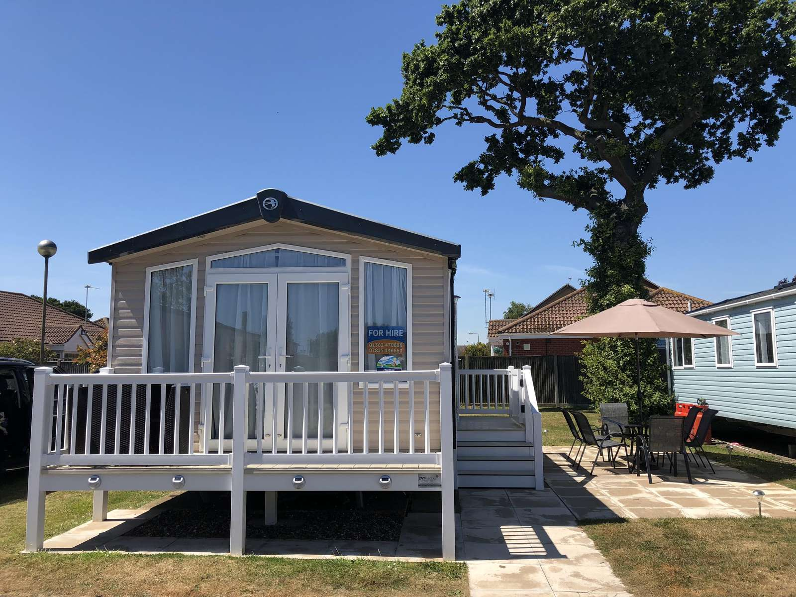 Caravan for hire with decking at Hopton Holiday Village