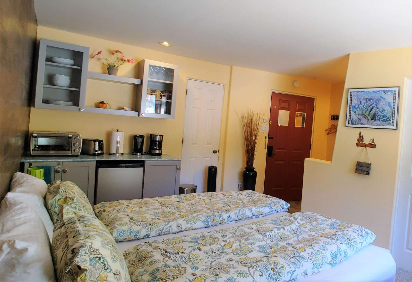 King bed and breakfast bar in #202 facing condo entrance door to 202 and privacy door to #201