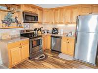 Remodeled kitchen is fully equipped - cook meals in your condo! thumb