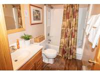 Enlarged bathroom with shower and tub. Towels provided! thumb