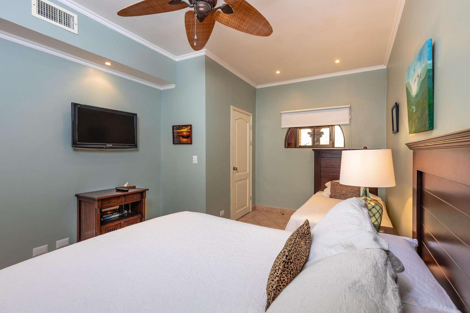 Guest bedroom, Queen bed and twin bed, Flat screen TV, full bathroom