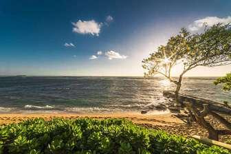 Sunrise at our beach front area at Tiki Moon Villas thumb