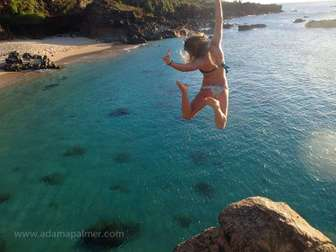 The jump from the rock at Waimea beach park is only 20 minutes from Tiki Moon Villas: fun to watch others jumping or try yourself! thumb
