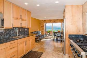 Large kitchen and dining area facing ocean. The beach is right outside of doors thumb