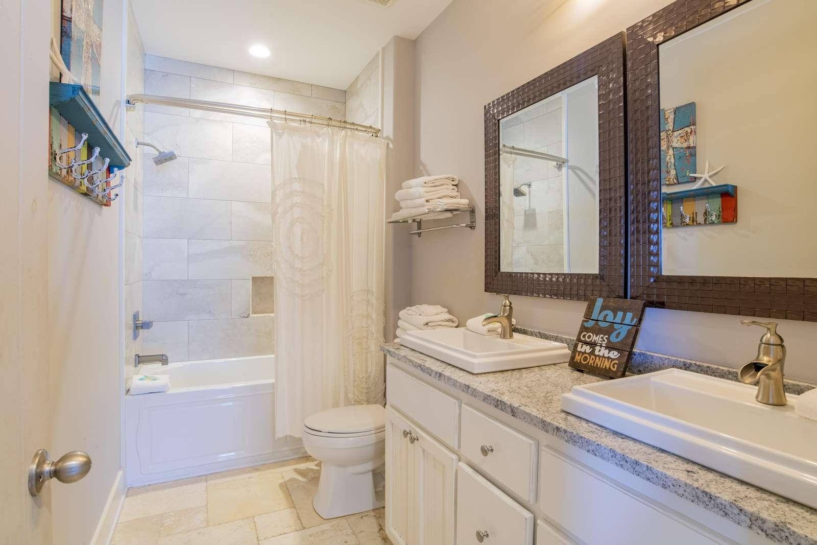 Both Bunk Rooms Share this bath and a half bath off 3rd floor den.
