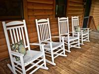 Old fashioned Rocking Chairs, and two Spacious Covered Decks to enjoy the outdoors rain or shine! thumb