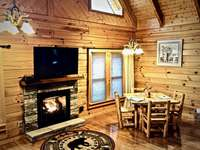 Open Floor Plan with Log Dining Set thumb