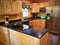 Kitchen is fully stocked and the Granite counter tops offer ample space to Prepare your Meals!  thumb