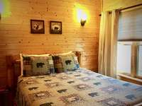 Second Master Queen suite upstairs offers Luxury Linens and Bear themed Decor thumb