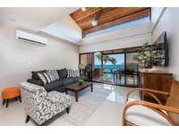 Living area, large Flat Screen TV, Ocean views thumb