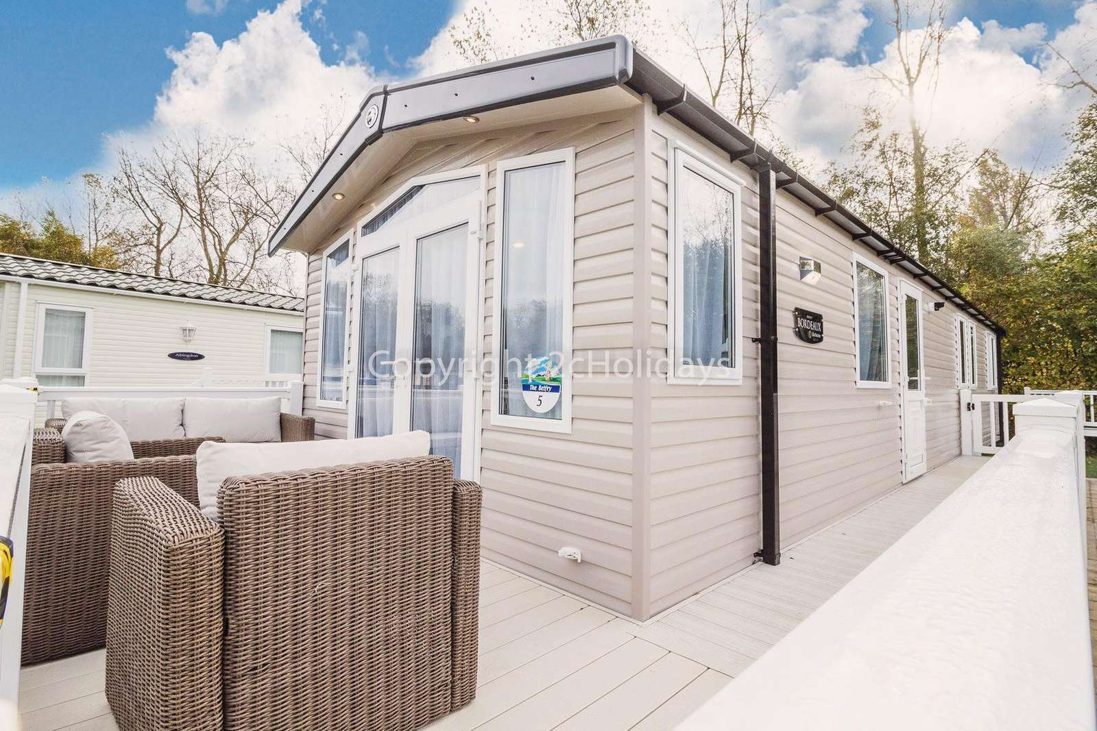 Caravan for hire with decking at Hopton