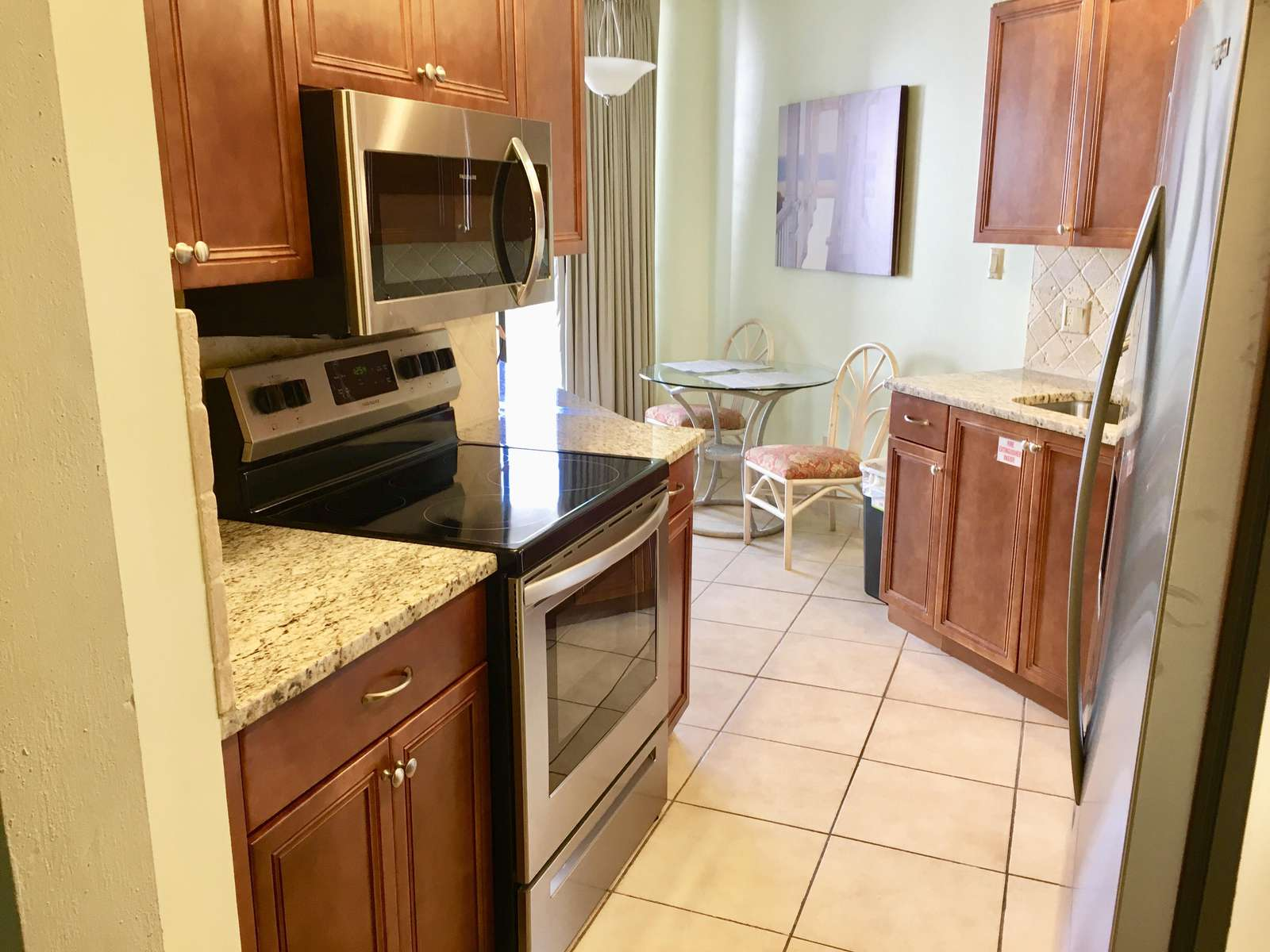 The recently renovated kitchen has new granite counter-tops and all new stainless steel appliances.