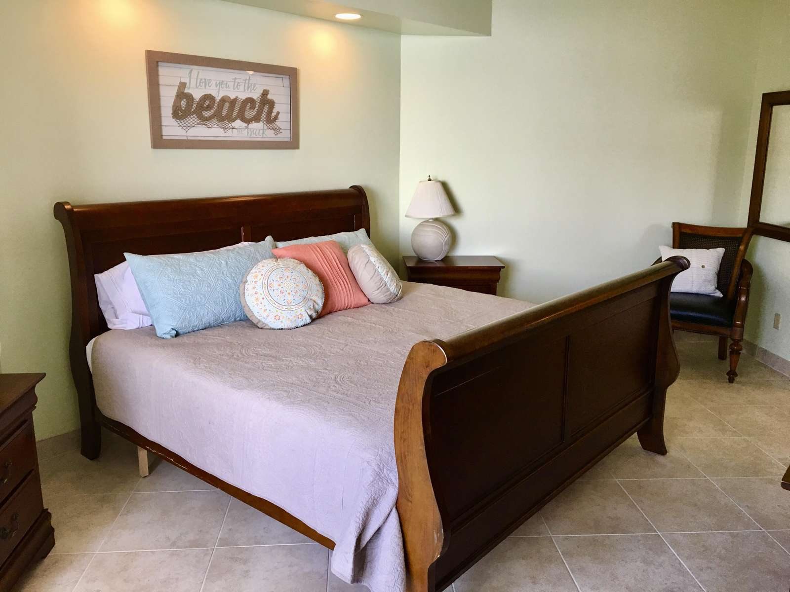 The master bedroom features a king sized bed.