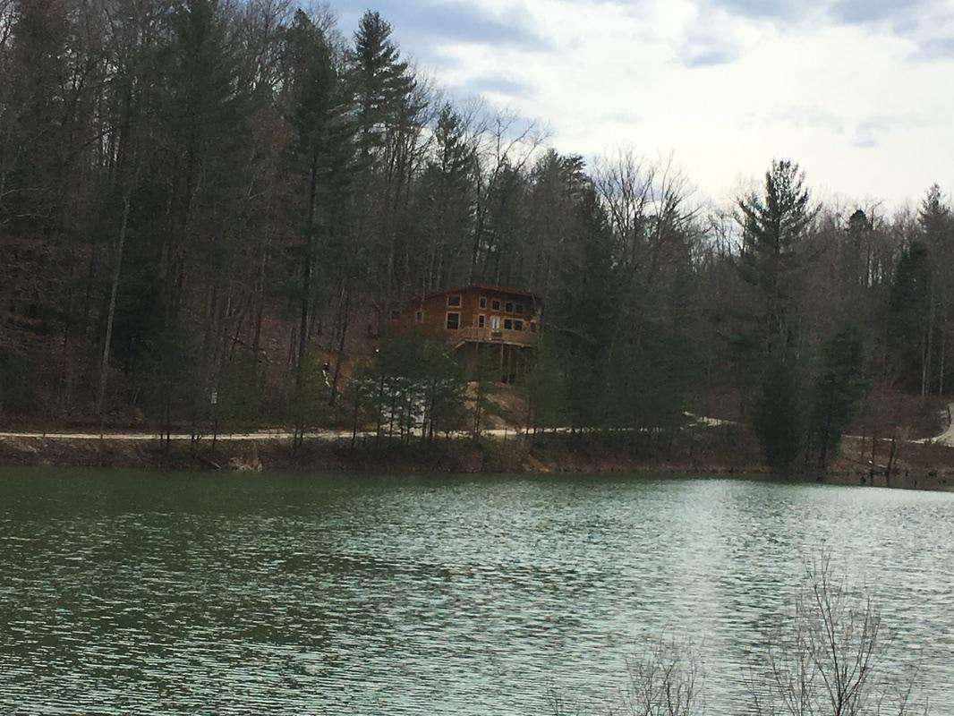 View of cabin from across lake