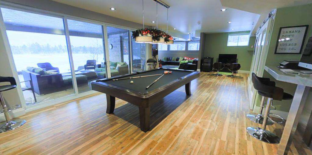 Lower floor entertainment area with bar and walkout