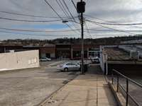 View of Court Street.  The rental parking (and property) is to the right, downtown is at the bottom of the hill. thumb
