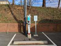 EV charging station in the parking lot across the street! thumb