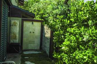 Additional private outdoor shower with hot & cold water. thumb