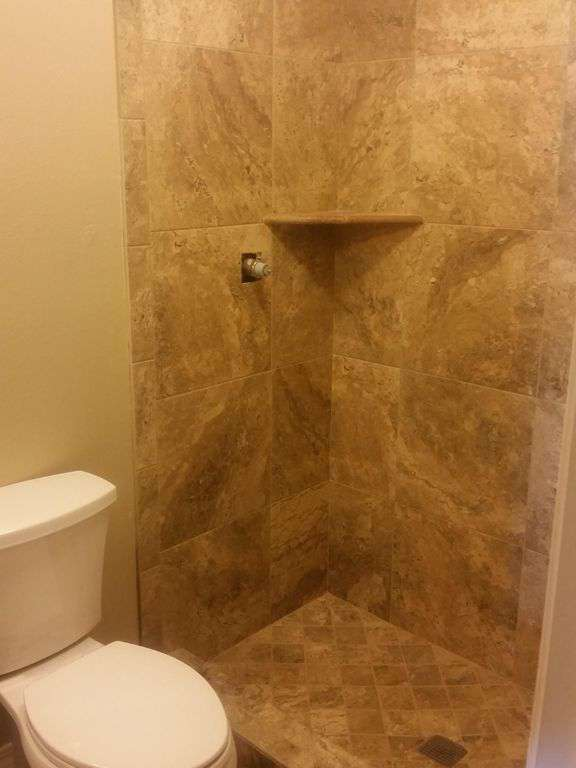 Two newly remodeled tile showers 2016.