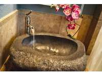 Detail of stone vanity sink in bedroom #2 bath area. thumb