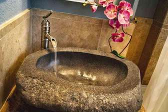 Detail of stone vanity sink in bedroom #2 bath area. thumb