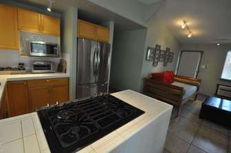 Closer view of kitchen. thumb