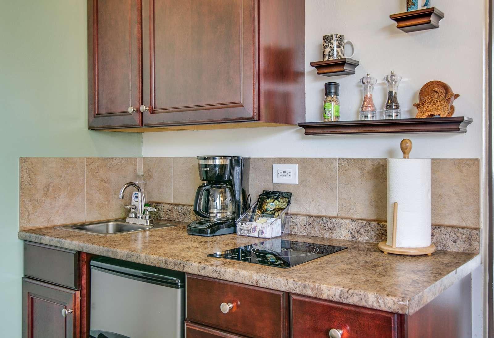 Granite counter over fridge and utensil storage