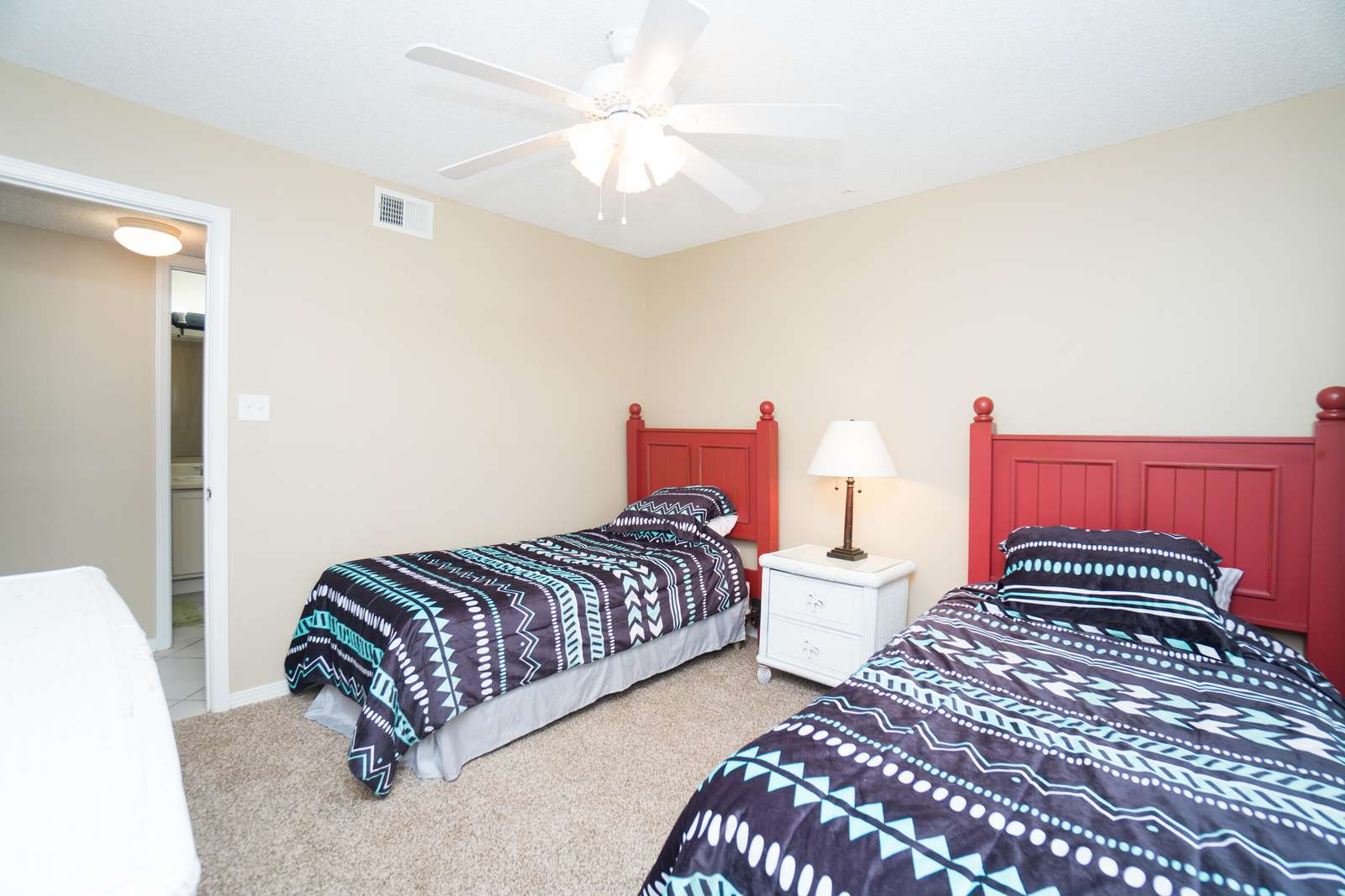 Spacious twin beds in the third bedroom