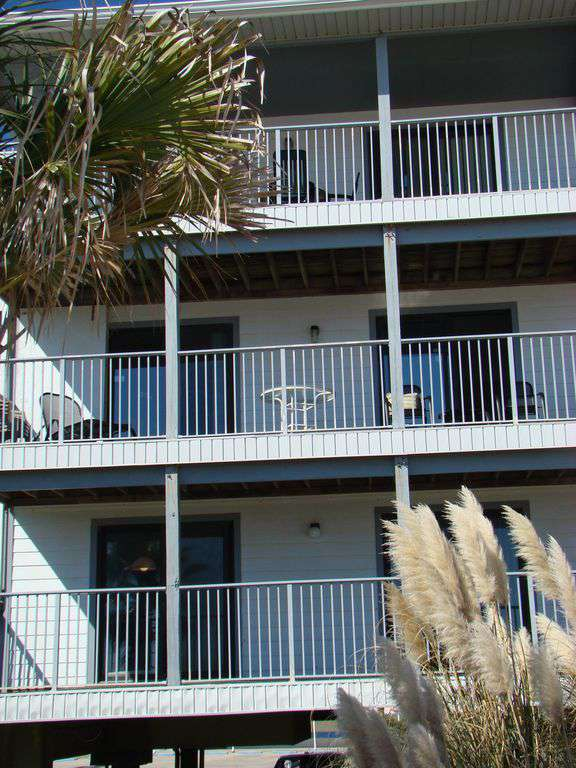 Close-up - Second floor double balcony overlooking beach and gulf.