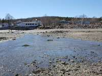 Walk on the beach at low tide (view from the water toward our unit).  thumb