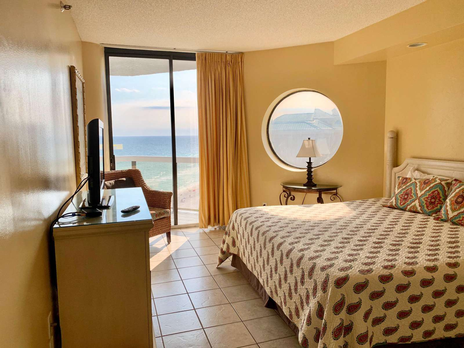 Master bedroom features a king bed, balcony access, great ocean views!
