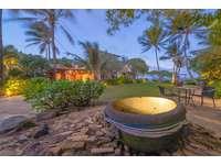 Evening view of lighting fixture in  ocean side garden of Tiki Moon Villas, Laie, Hawaii thumb