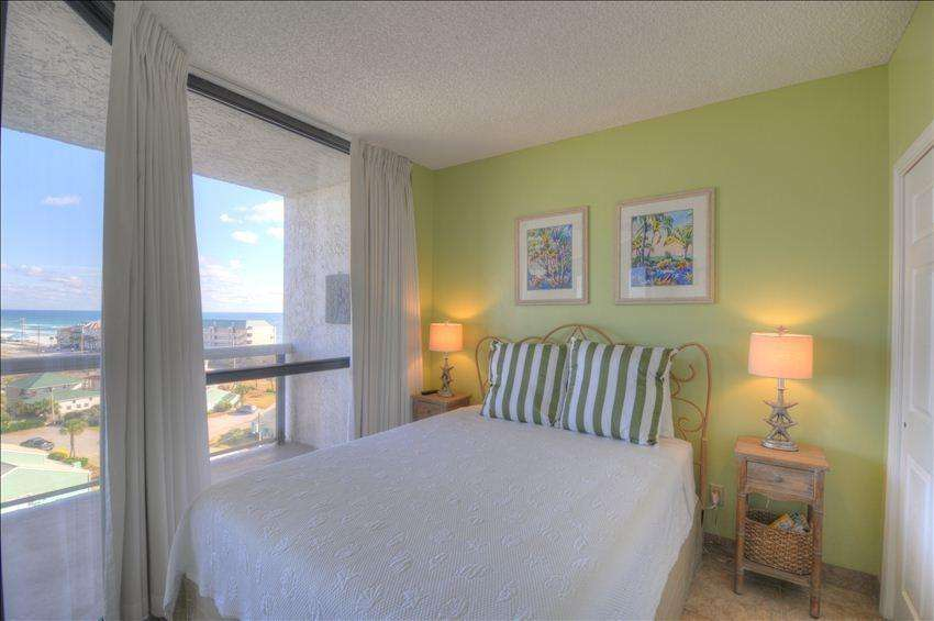 The second bedroom has balcony access and great views.