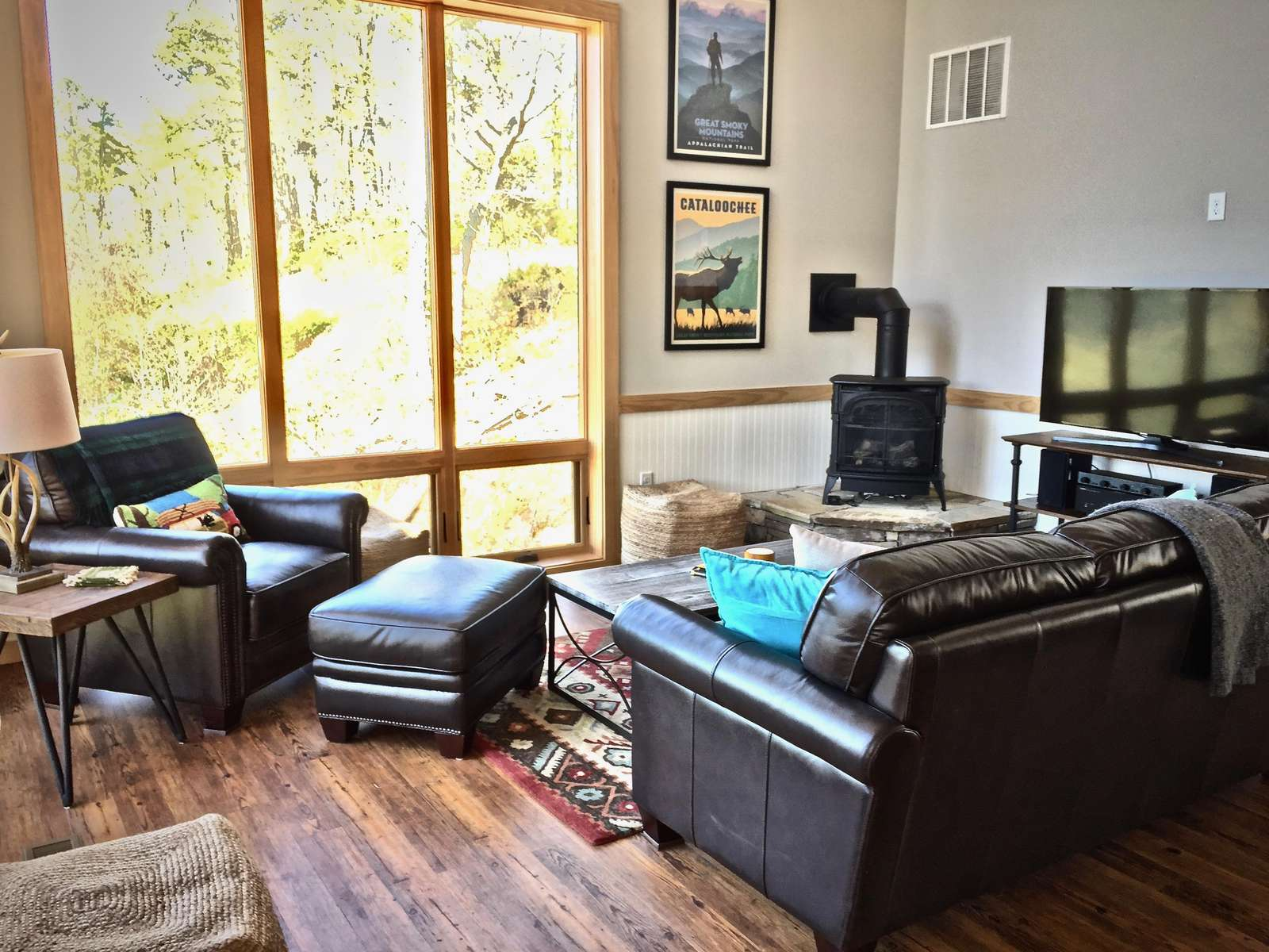 Living Room offers comfortable seating, a Cozy Wood Stove style Fire Place.